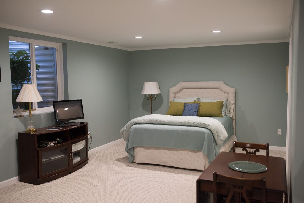spare bedroom in basement with egress window and bathroom