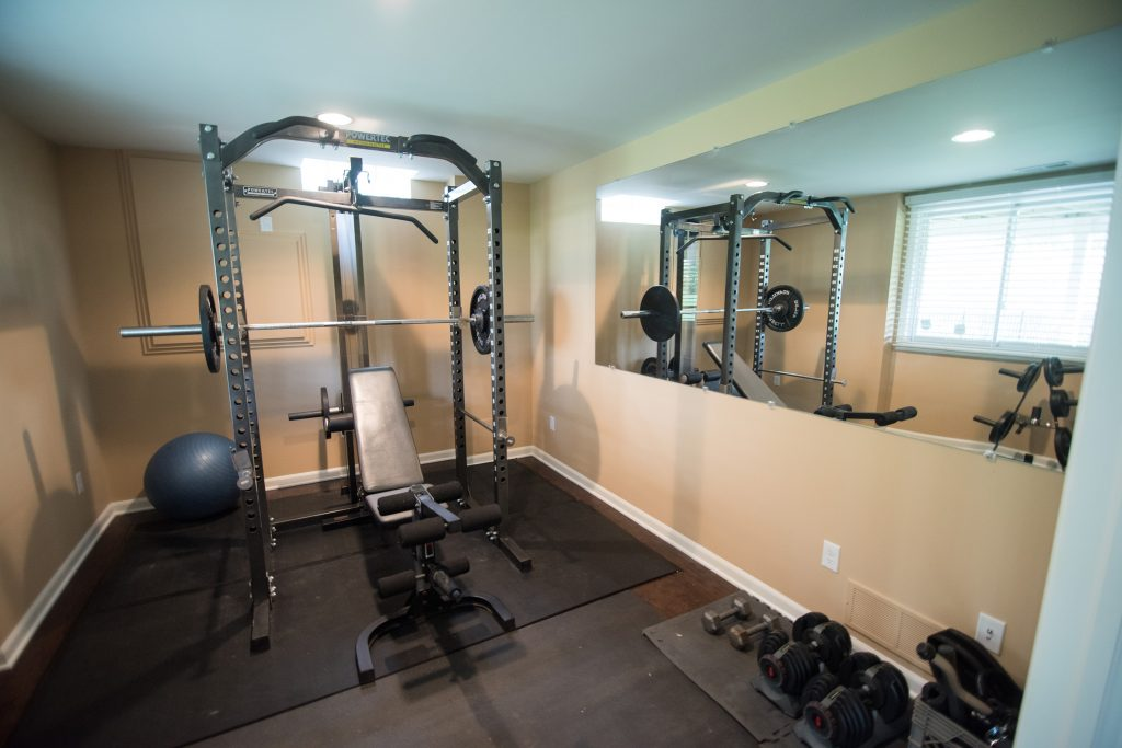 home fitness room in basement with french doors