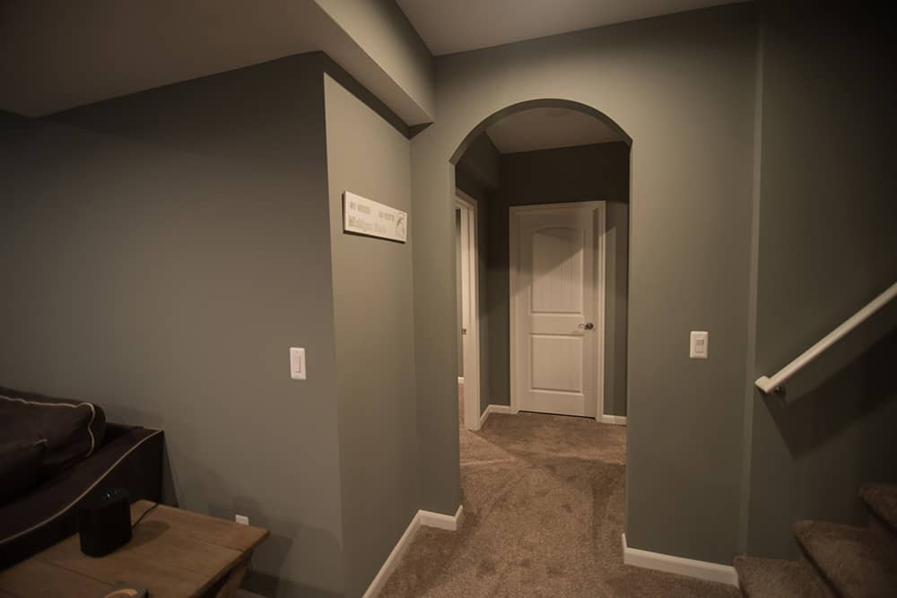archway design feature in basement hallway